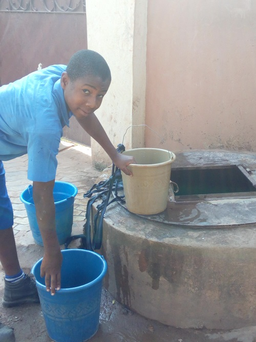 Boy by a well, Enugu