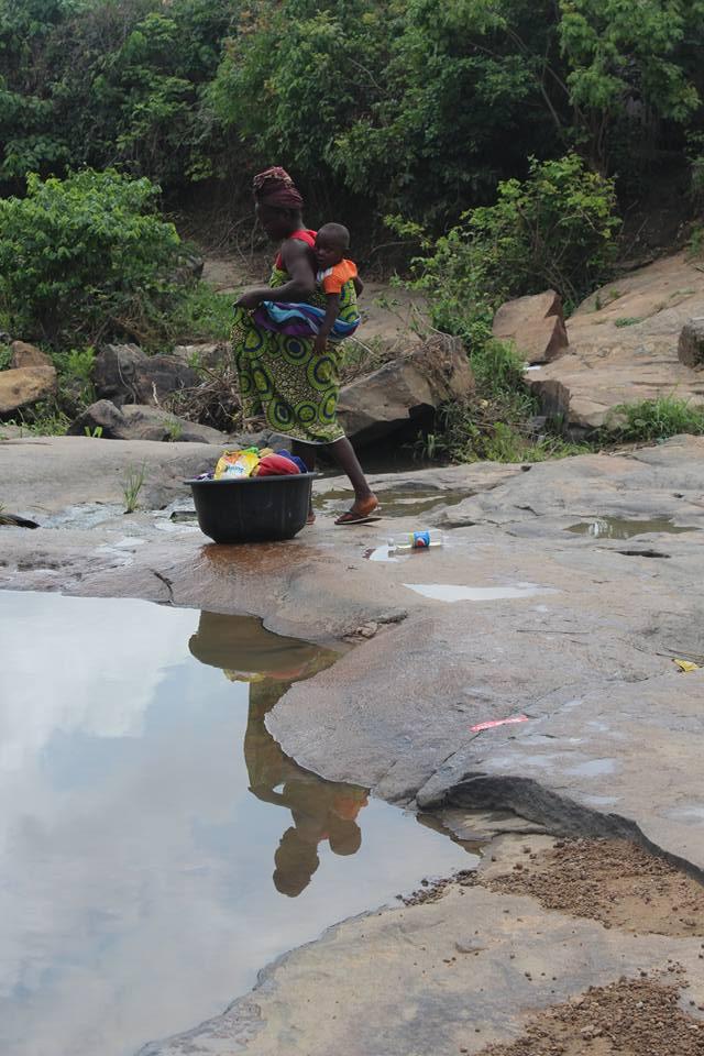 Zhidu community woman and child at water source